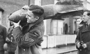 RAF sergeant carrying large bomb