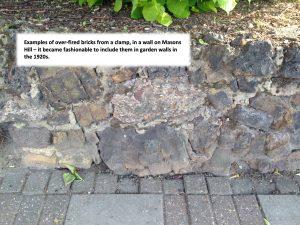 chunks of blacken bricks set at angles in a wall