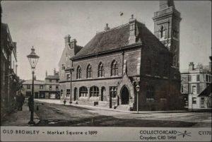 black and white photo of faintly Elizabethan brick style market hall