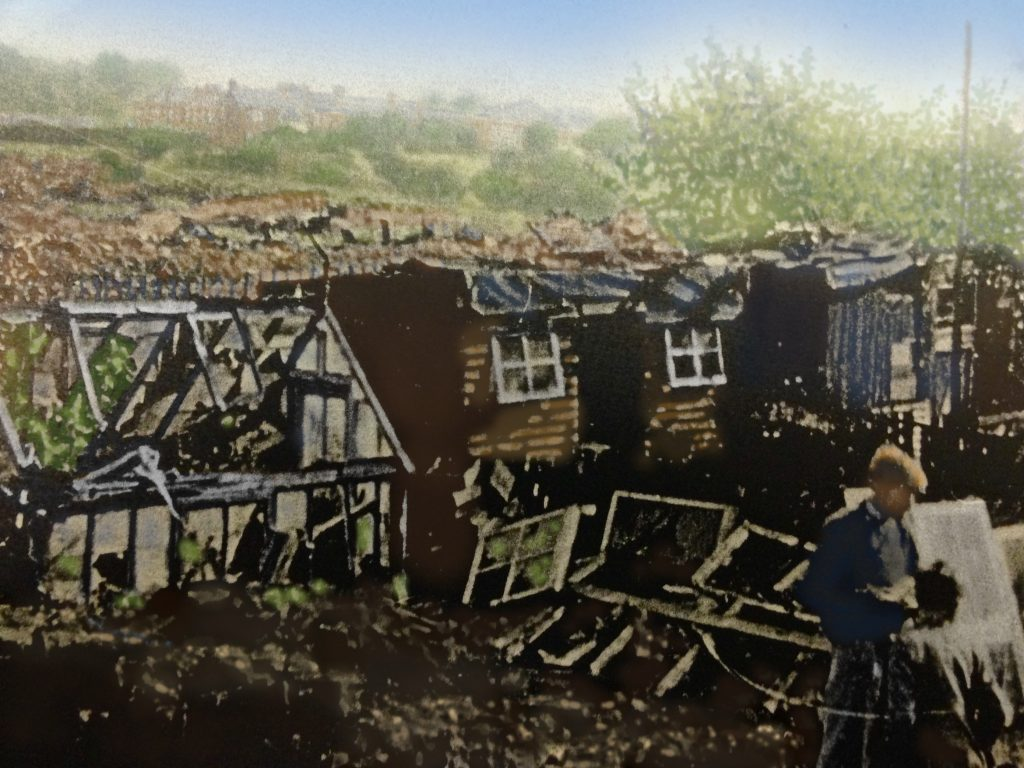 tinted pic of tumble down sheds and gardens