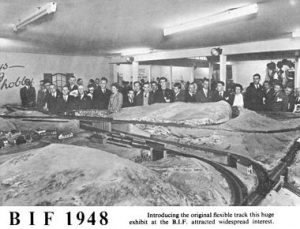 model railway with crowd around