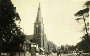 old black and white photo of Victorian church with spire